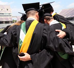 UNT Health Science Center graduates group hug